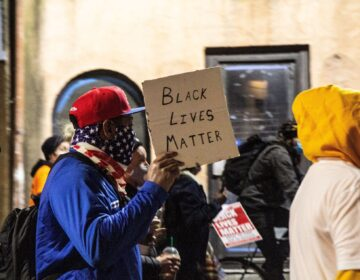 Protesters marched in Old City in honor of Walter Wallace Jr. after the release of officer body cam footage showing his fatal shooting. (Kimberly Paynter/WHYY)