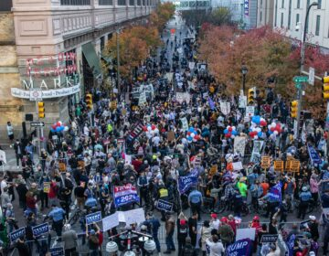 At 12th and Arch Streets in Philadelphia, protesters from both sides were separated by a line of police. (Kimberly Paynter/WHYY)