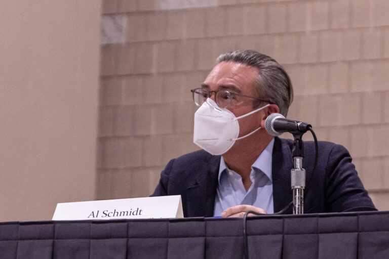 Philadelphia City Commissioner Al Schmidt wears a mask while sitting at a table