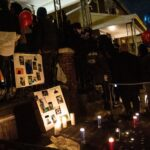 Photos and candles honor the life of Sadeek Clark-Harrison at a vigil for the 12 year-old who was killed at his home in Frankford Sunday. (Kimberly Paynter/WHYY)