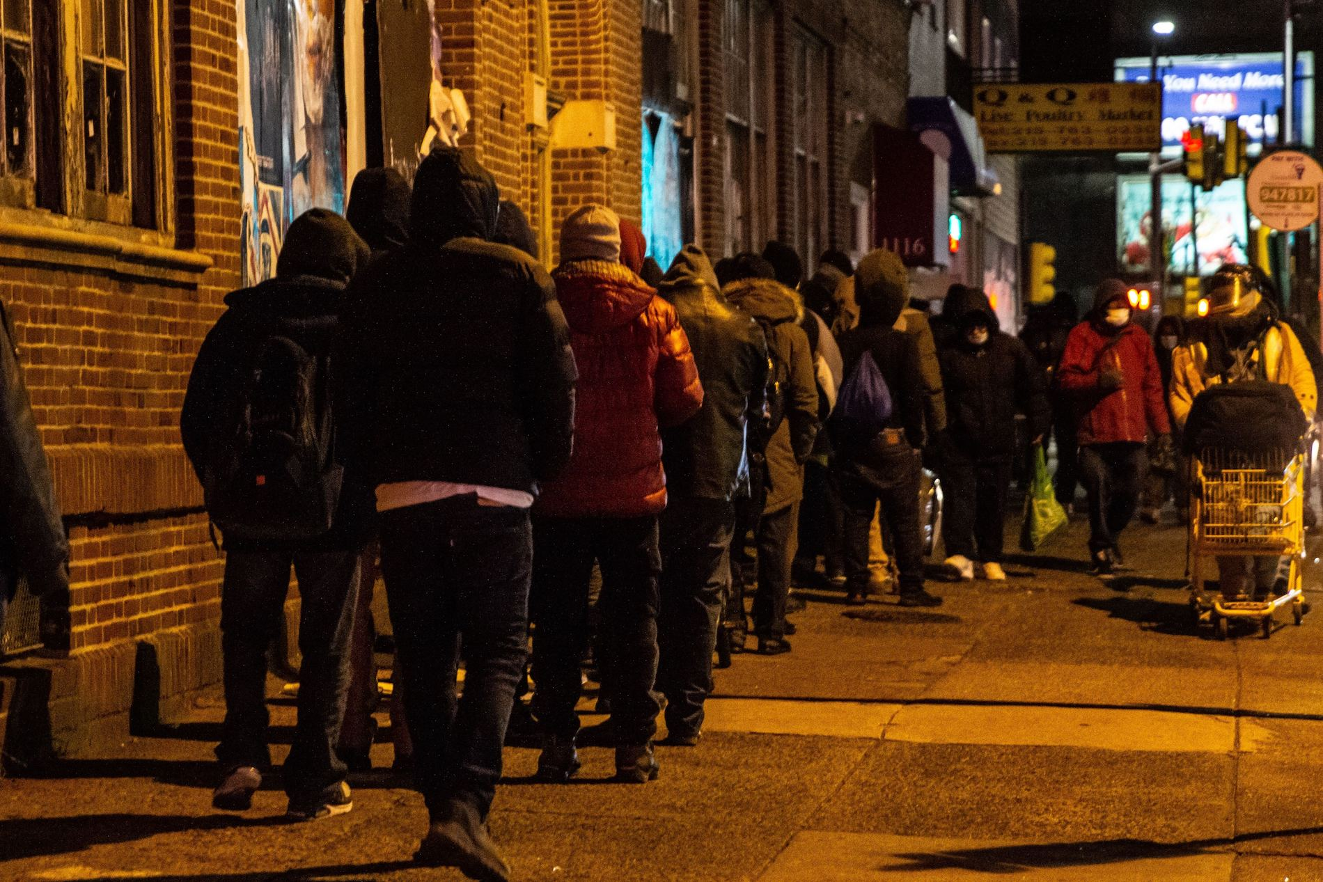 The line to receive hot food from Chosen 300 Ministries during their regular Wednesday meal on Spring Garden Street in Philadelphia.