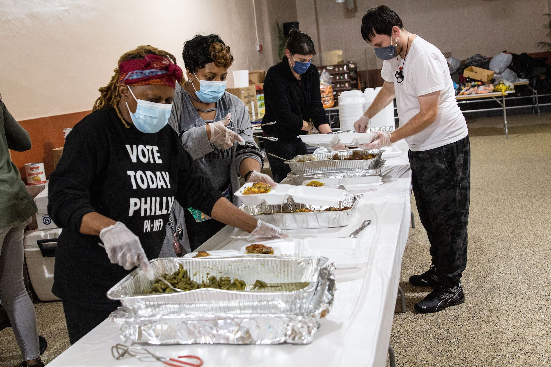 Volunteers at the Chosen 300 Ministries prepare meals for those in need on Spring Garden Street.