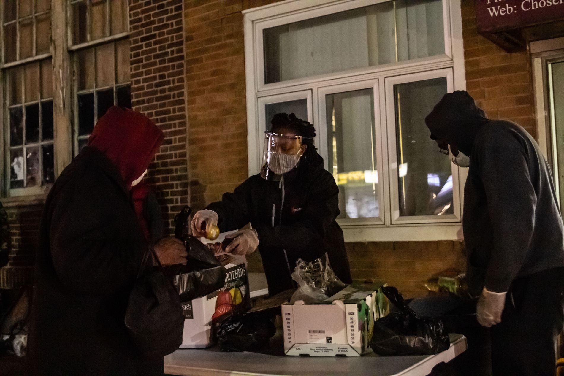 Sherica Douglas hands out fresh fruit with hot food at the Chosen 300 Ministries.