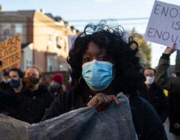"Ebony Powell is the organizer of the ""Enough is Enough"" campaign. University of Pennsylvania students marched to UPenn's campus in protest of the school's lack of investment in the community and over-policing. (Kimberly Paynter/WHYY)"