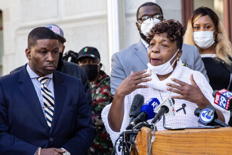 Shaka Johnson, attorney for the Wallace family, (left) and Gwen Carr (right), mother of Eric Garner, spoke in support of the Wallace family and Wallace's mother who is bedridden with grief. (Kimberly Paynter/WHYY)