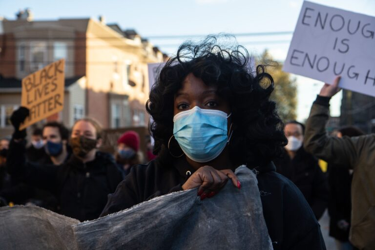 """Ebony Powell is the organizer of the """"Enough is Enough"""" campaign. University of Pennsylvania students marched to UPenn's campus in protest of the school's lack of investment in the community and over-policing. (Kimberly Paynter/WHYY)"""