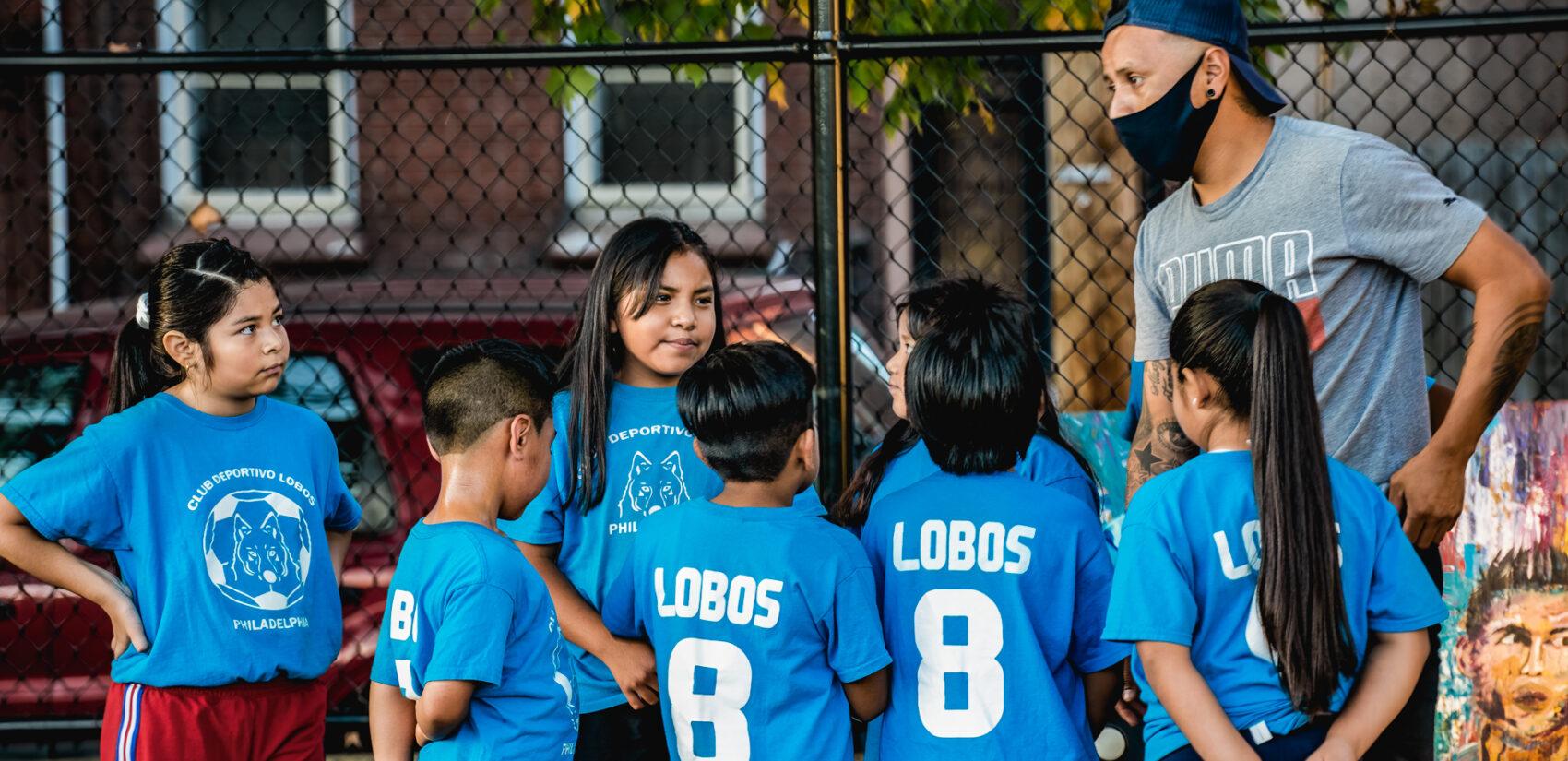 In contrast to the tradition in soccer, the league's teams are mixed-gender. | En contraste con la tradición en el fútbol, los equipos de la liga son mixto con hembras y varones. (Photo by Eugenio Salas for WHYY)