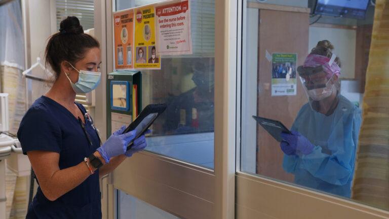 Resident Nurse Lea communicates via iPad with another nurse