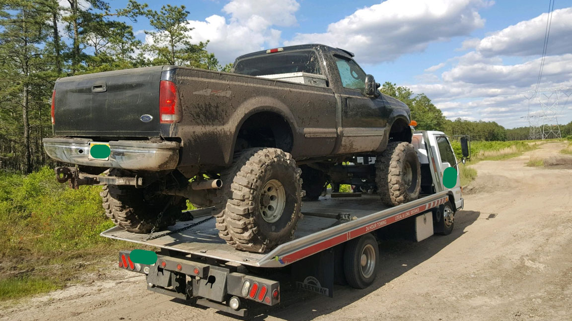 DEP officials impound a pickup truck that was being illegally driven in the Pinelands.