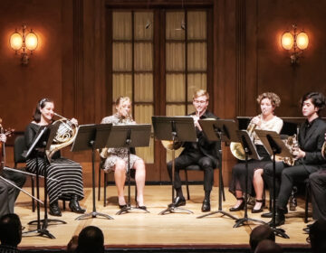 Martina Smith and other Curtis Institute of Music students playing the horn on stage