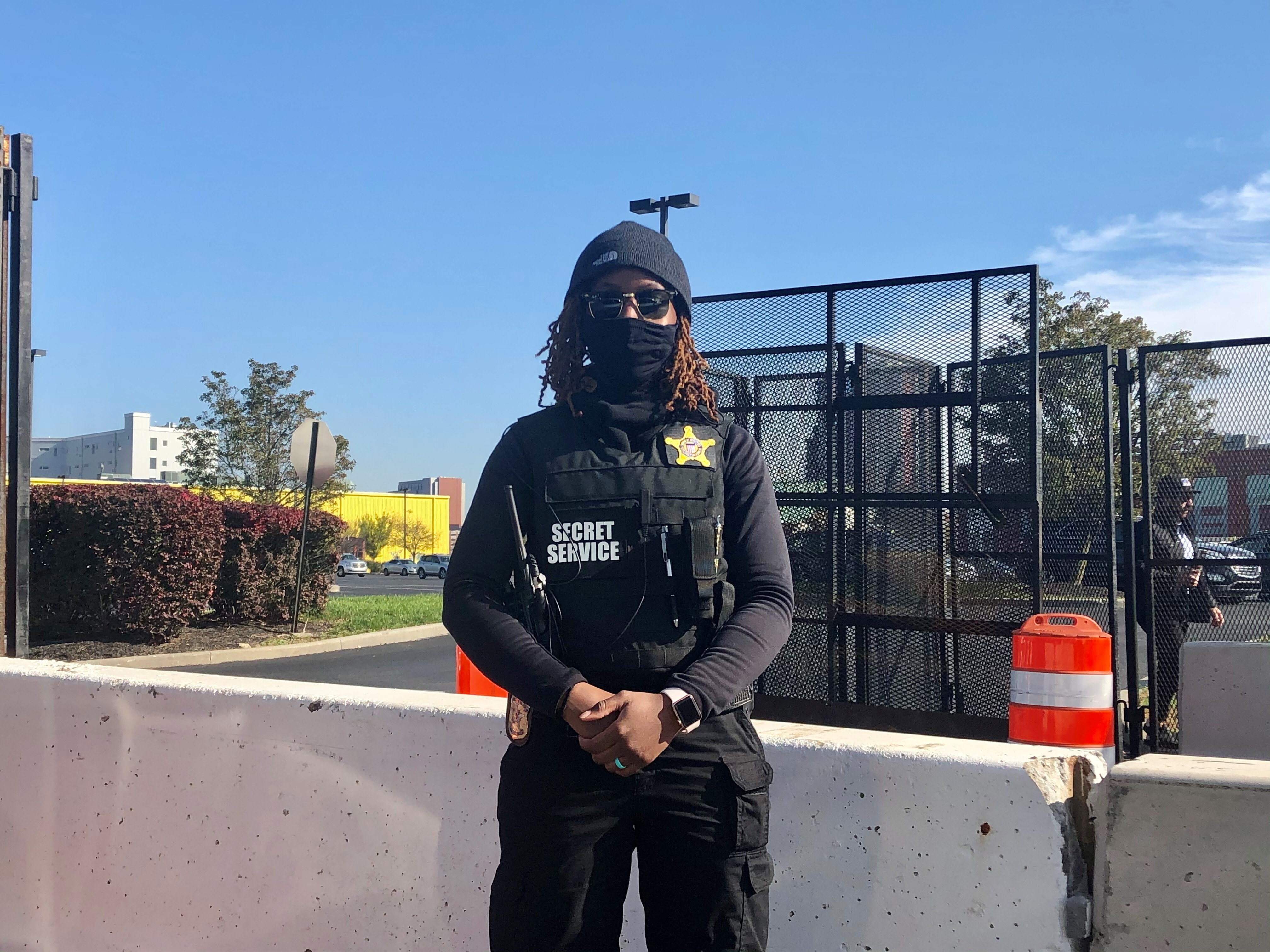 A Secret Service agent stands guard at the entrance to a heavily fortified section of road to the Chase Center on Wilmington's riverfront on Friday morning.