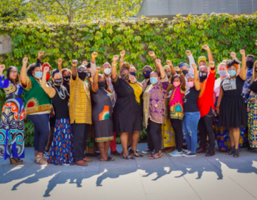 Mary McLeod Bethune Elementary principal Aliya Catanch-Bradley raises her fist with her staff during a recent birthday photoshoot at the Barnes Foundation. (Aliya Catanch-Bradley)