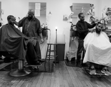 G and his colleague both cutting the hair of clients. (Photo by Antonio Johnson/Produced at Gamin' Cutz in Philadelphia, PA. December 2019.)