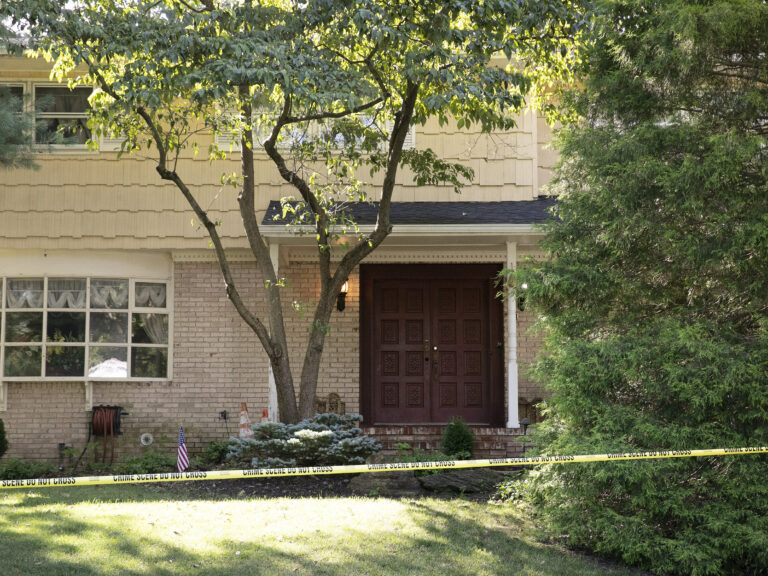 Crime-scene tape surrounds the home of federal Judge Esther Salas in North Brunswick, N.J., on July 20. A gunman shot and killed Salas' 20-year-old son and wounded her husband. (Mark Lennihan/AP Photo)