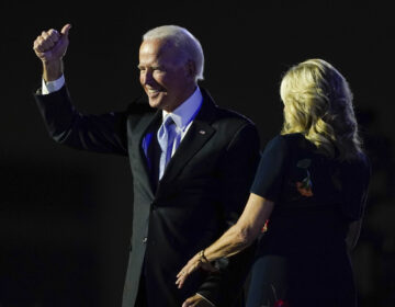 President-elect Joe Biden stands on stage with his wife, Jill Biden, on Saturday in Wilmington, Del. (Carolyn Kaster/AP Photo)