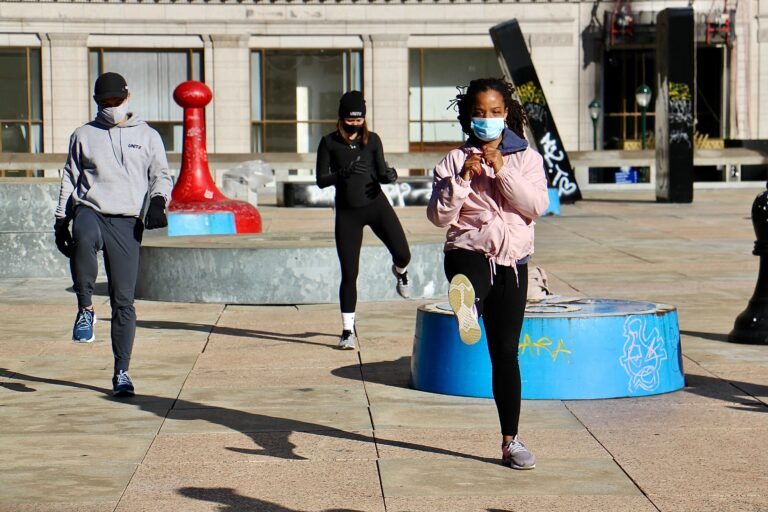 About 25 fitness enthusiasts participate in a protest workout at Thomas Paine Plaza to support gym owners who have been shut down by the coronavirus pandemic.