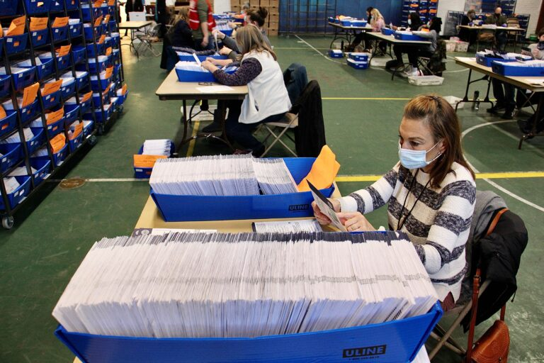 Chester Country election workers check ballots one last time before sending them to be scanned and counted