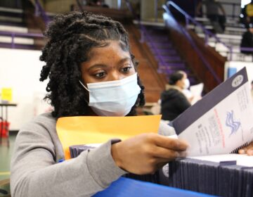 Chester Country election worker Jessica McPherson inspects ballots