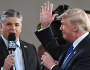 Fox News host Sean Hannity interviews President Trump in Las Vegas in 2018. Hannity, like Trump, has cast doubt on the 2020 election results without providing evidence. (Ethan Miller/Getty Images)