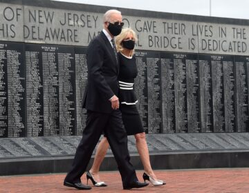 Joe Biden and his wife Jill Biden wear masks as they mark Memorial Day, on May 25. The president-elect has consistently worn masks amid the pandemic, and is calling for a national mask mandate. (Olivier Douliery/AFP via Getty Images)