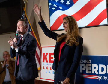 Sens. David Perdue and Kelly Loeffler speak at a campaign event this month at a restaurant in Cumming, Ga. Both are competing in runoff elections in January that will determine which party controls the Senate. (Megan Varner/Getty Images)