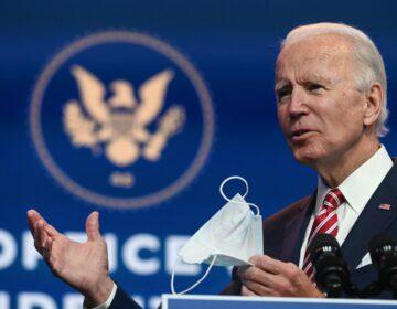President-elect Joe Biden holds a face mask