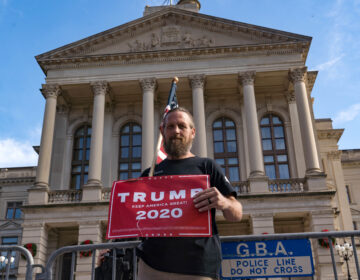 Supporters of Donald Trump host a 'Stop the Steal' protest outside of the Georgia State Capital