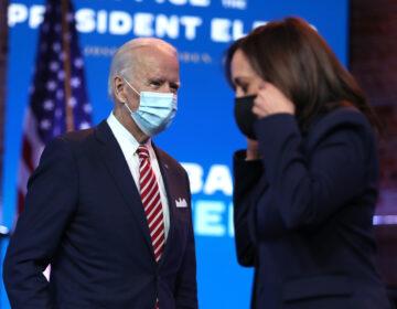 President-elect Joe Biden walks by Vice President-elect Kamala Harris