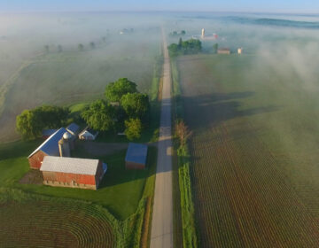 Perfectly scenic aerial view of rural Wisconsin on a foggy spring morning.