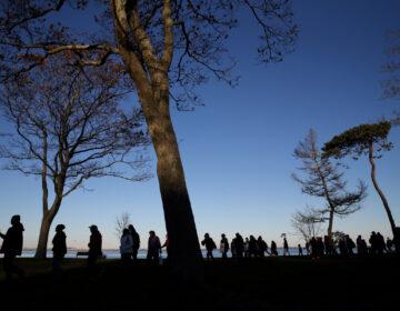 Marchers perform a Stomp Dance in Pilgrim Memorial State Park