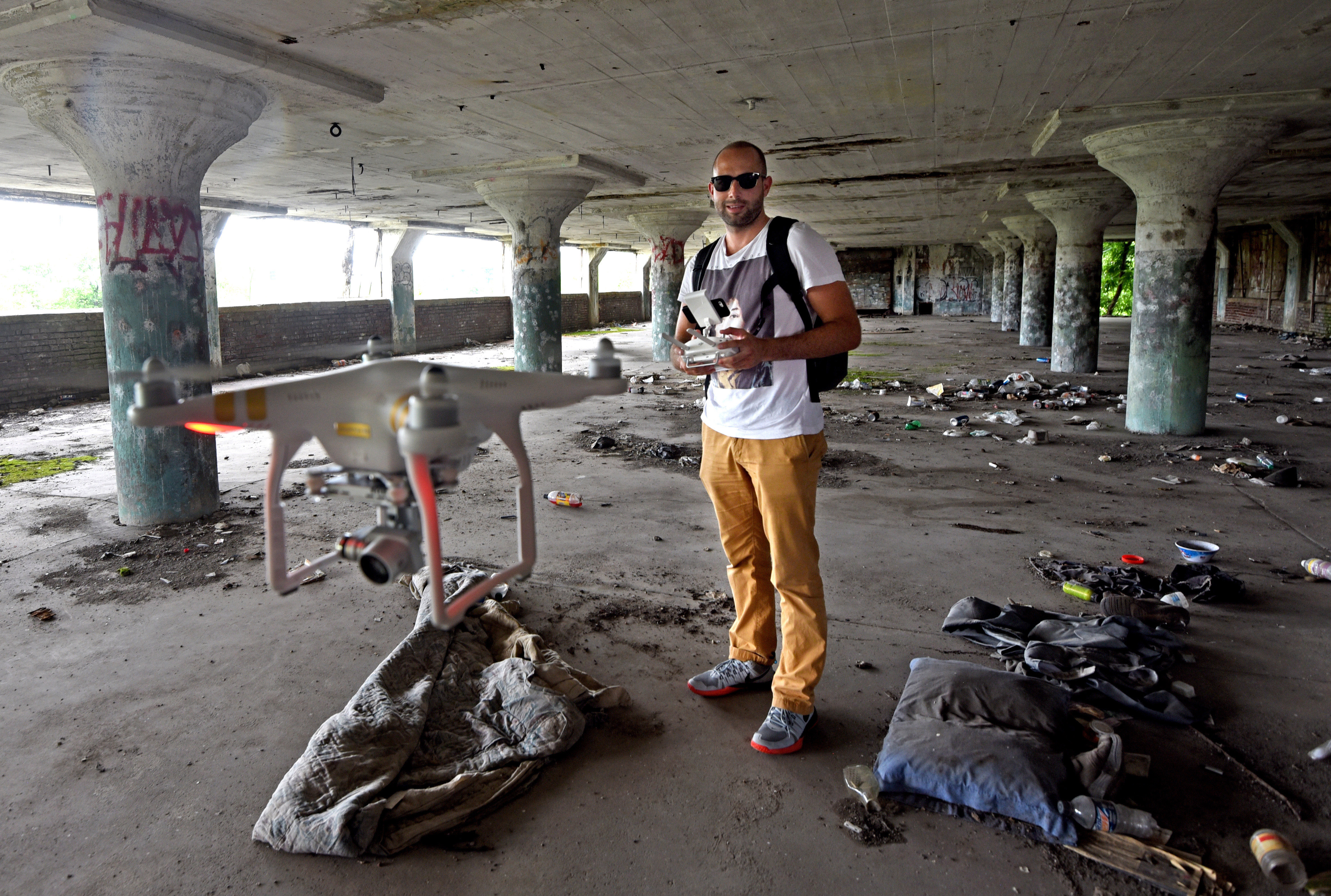 In 2016, Hasan Oswald flies a drone inside an abandoned warehouse in Camden, New Jersey