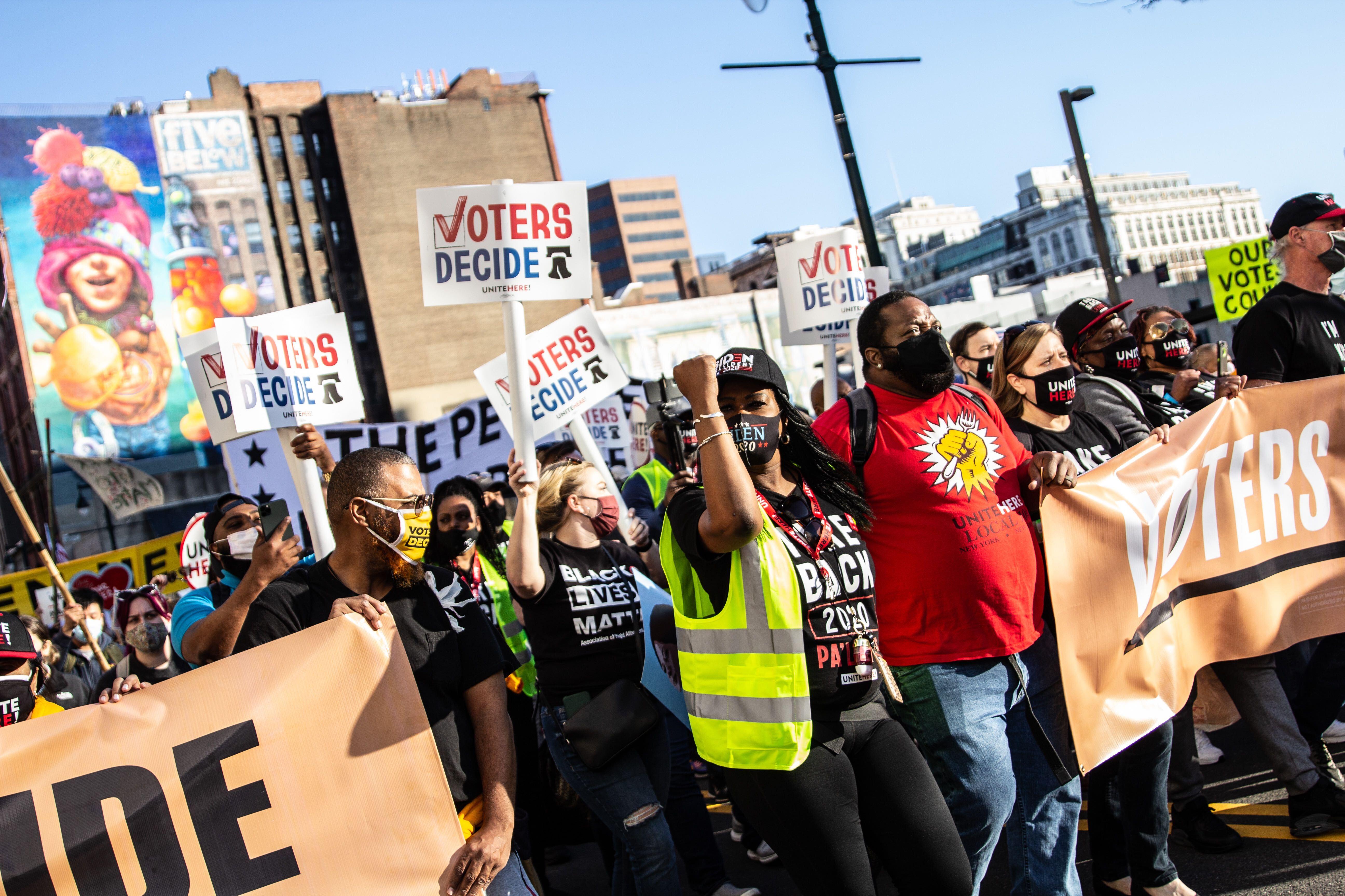 Demonstrators march through Center City Philadelphia to celebrate a Biden win.