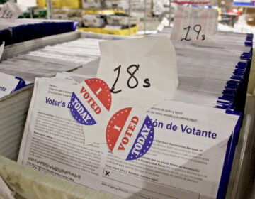 Philadelphia's mail-in ballots are kept in a secure area at the Pennsylvania Convention Center, where the city has set up its ballot counting operation. They cannot be counted until Election Day. (Emma Lee/WHYY)
