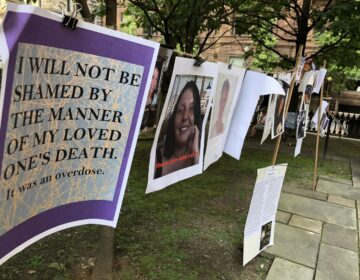Photographs and words of recovery hang near Trinity Cathedral in downtown Pittsburgh as part of a remembrance of victims during Overdose Awareness Day