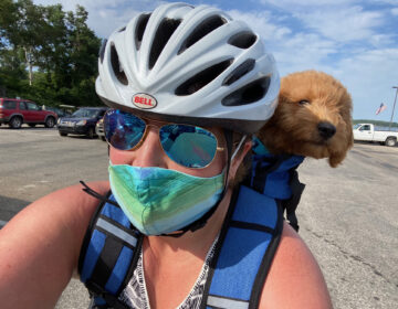 Devin Green rides a bike with her pup Taco