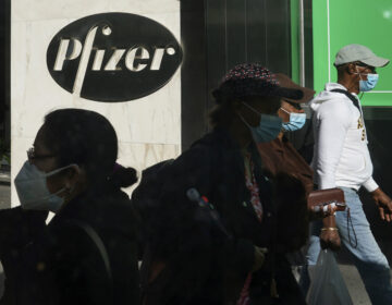 Pedestrians walk past Pfizer world headquarters