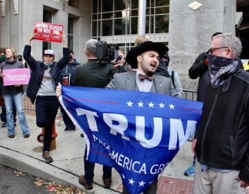 Trump supporters gather in front of the Pennsylvania Convention Center to object to the way votes are being counted there.