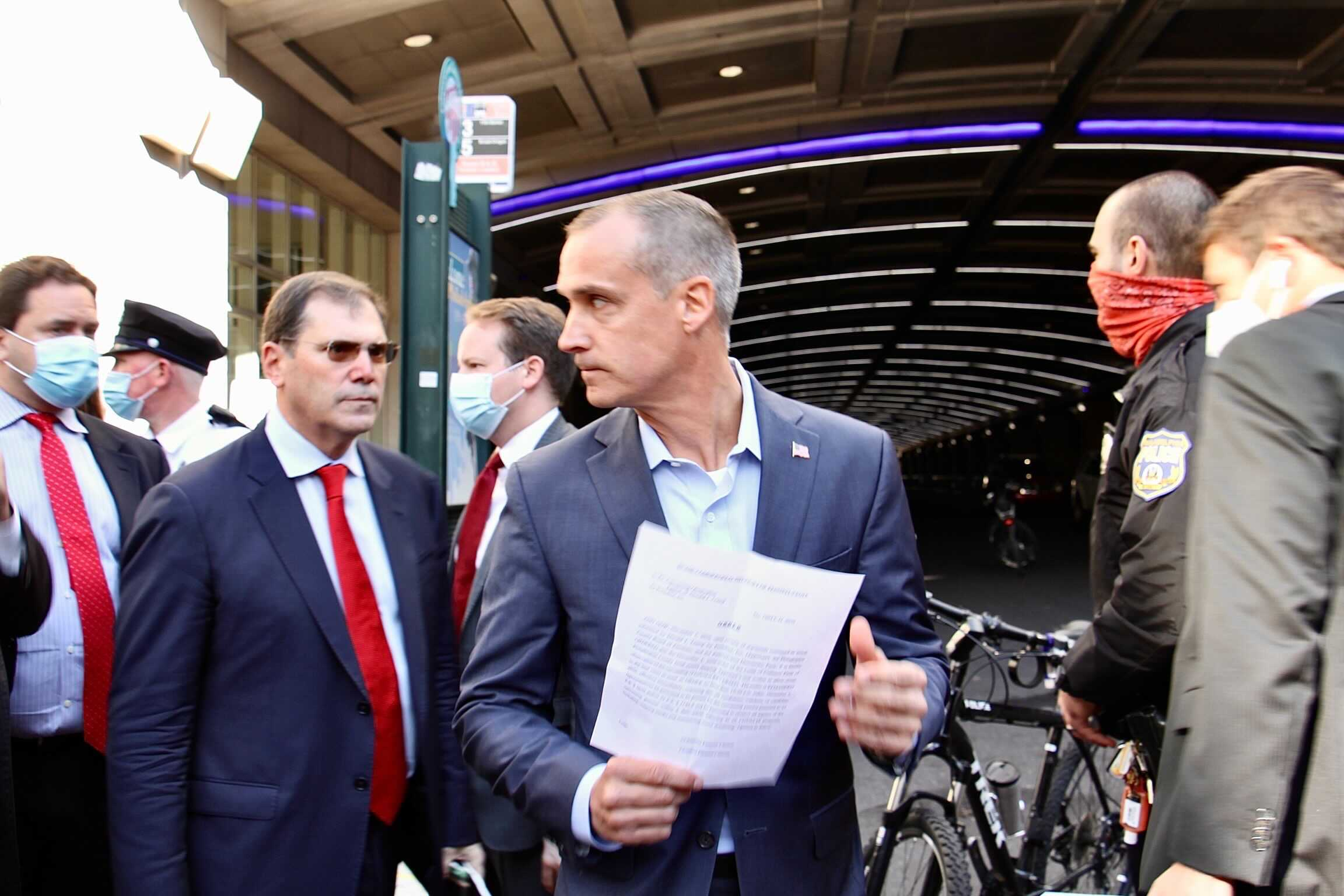 Trump operative Corey Lewandowski addresses reporters at Pennsylvania Convention Center, where Philadelphia votes are being counted, while armed with what appears to be a court order.