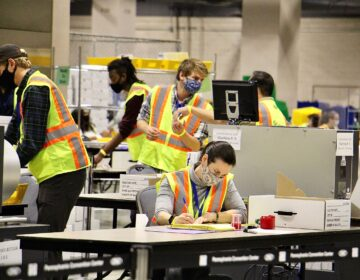 Election workers scan ballots at the Pennsylvania Convention Center.