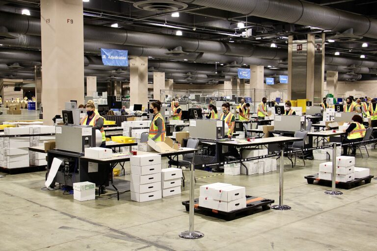 Election workers scan ballots at the Pennsylvania Convention Center. Officials anticipate that the task of scanning mail and absentee ballots will be completed Thursday.