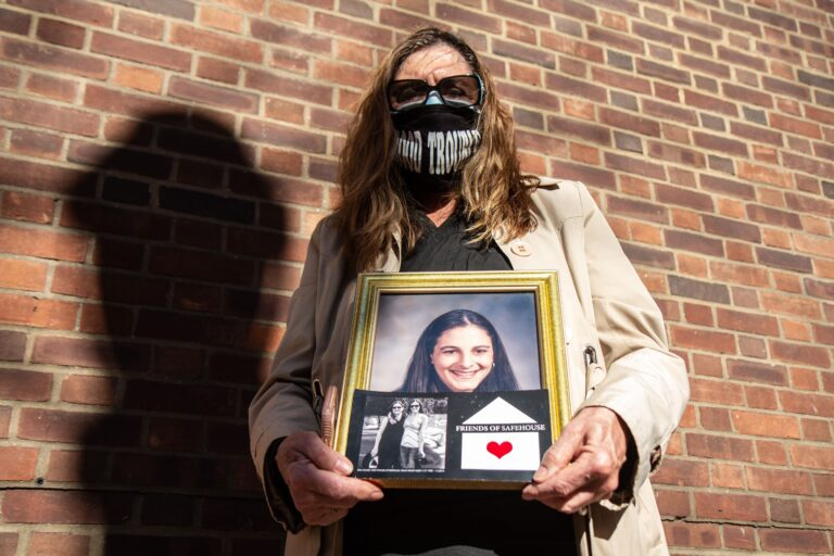 Elise Schiller holds a photo of her daughter Giana Natali