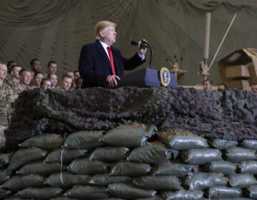 President Trump speaks to U.S. troops at Bagram Airfield, Afghanistan, on Thanksgiving Day 2019. The Trump administration says it's cutting U.S. forces from 4,500 to 2,500 troops in Afghanistan, one of several abrupt military moves announced recently. (Alex Brandon/AP)