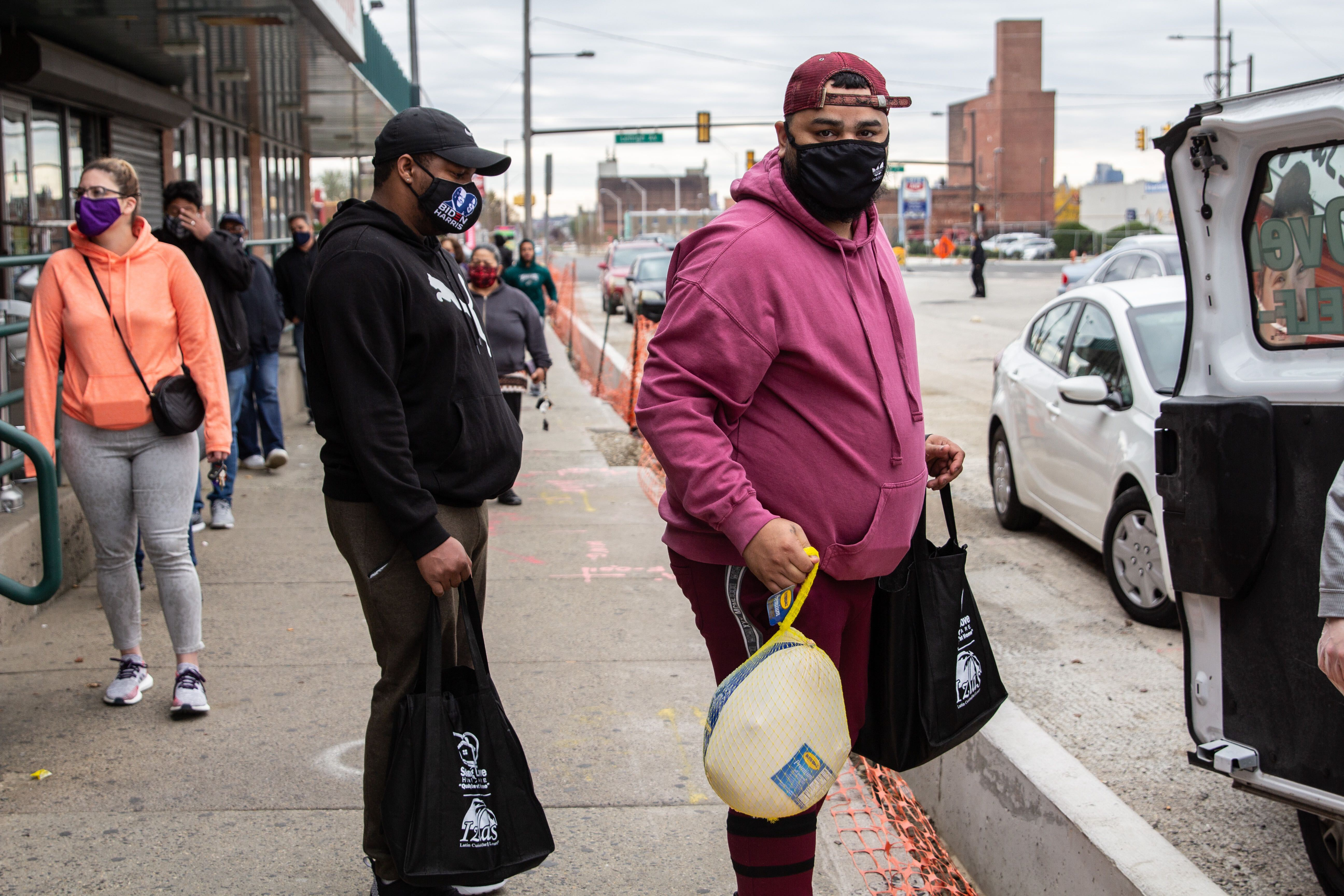 Kensington resident Alex Pagan waits in line for a free Thanksgiving turkey for his family.