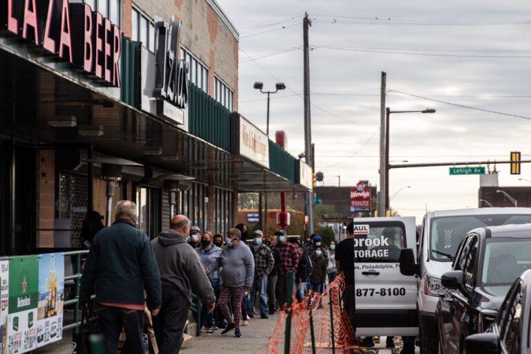 Philadelphians line up outside Izlas restaurant in Kensington for a free Thanksgiving turkey.