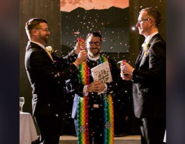 Rev. Fritz Fowler (center) marries Ted Sayland (left) and Rusty McCarty (right) in 2018. (Courtesy of Abigail Townsend Photography)