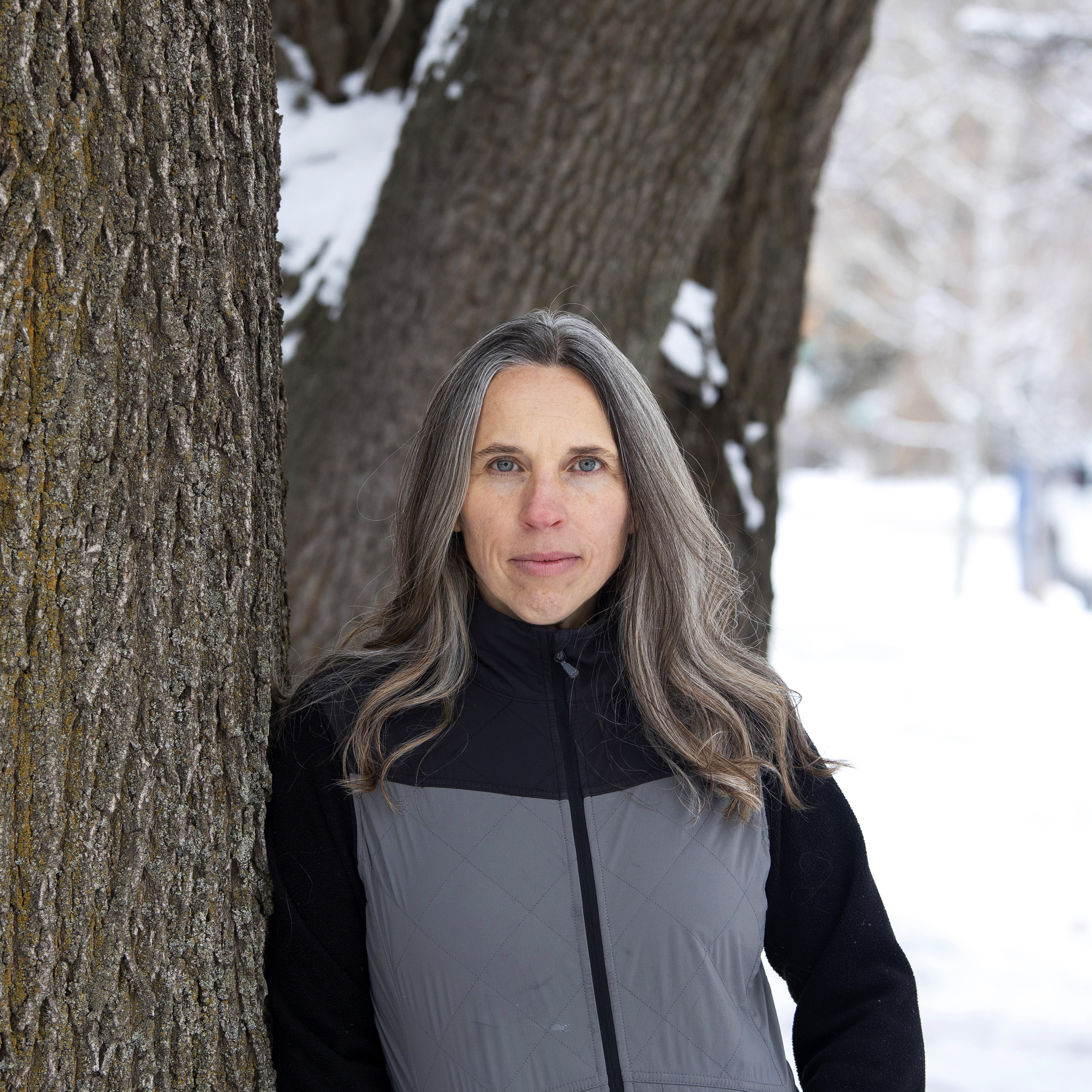 On December 15, 2020, in Bozeman, Montana, Angela Kociolek stands for a portrait by a tree in her front yard.