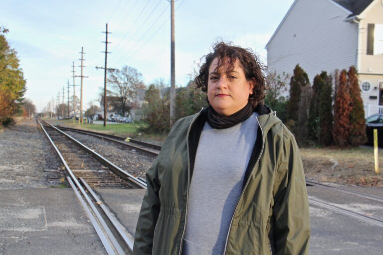 Vanessa Keegan, 41, lives in Gibbstown with her boyfriend and 3-year-old son one block from the railroad tracks that will carry liquid natural gas to an export facility on the Delaware River. (Emma Lee/WHYY)
