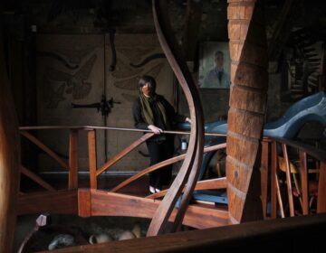 Julie Siglin looks at the sculptures displayed in Wharton Esherick's home studio