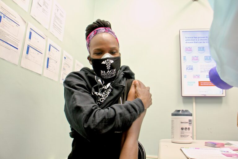 Dr. Ala Stanford gets her COVID-19 vaccination at a Philadelphia Department of Health clinic on Dec. 16, 2020. (Emma Lee/WHYY)