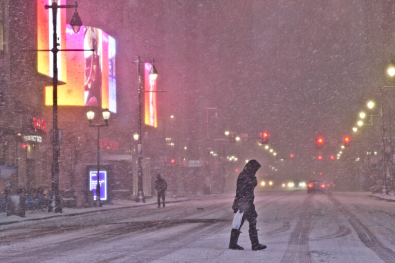 Snow falls on Market Street during a snow storm on December 16, 2020. (Kimberly Paynter/WHYY)